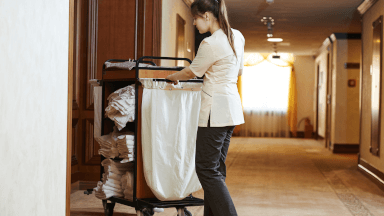 Preparing a guest room for cleaning