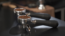 Distributing and tamping espresso coffee